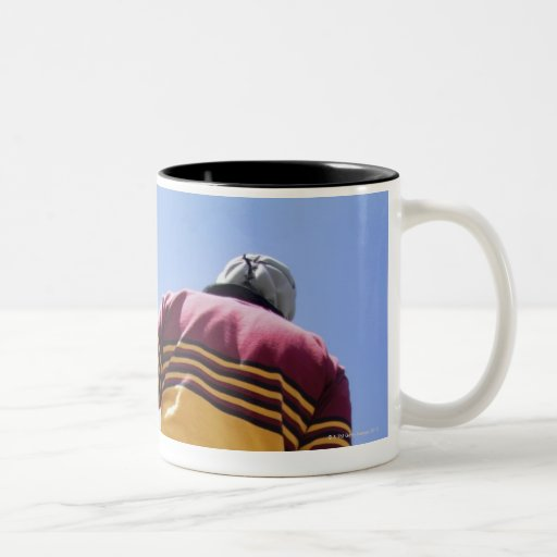 Rugby player on the sideline with refreshments Two-Tone coffee mug