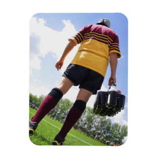 Rugby player on the sideline with refreshments rectangular magnets