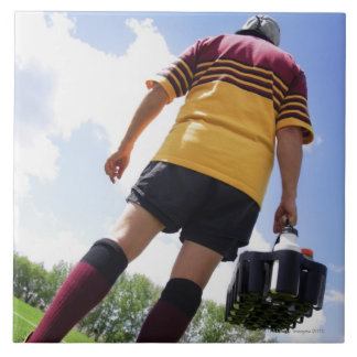 Rugby player on the sideline with refreshments large square tile