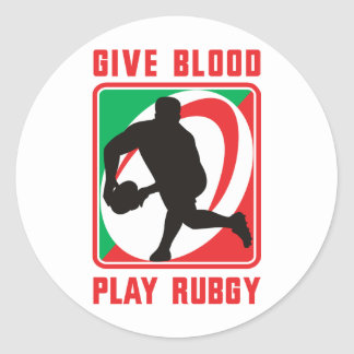 Rugby player passing ball front give blood play round sticker