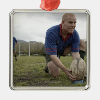 Rugby player positioning ball on rugby pitch metal ornament