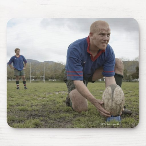 Rugby player positioning ball on rugby pitch mousepads