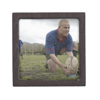 Rugby player positioning ball on rugby pitch premium jewelry box
