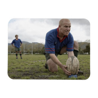 Rugby player positioning ball on rugby pitch rectangular photo magnet