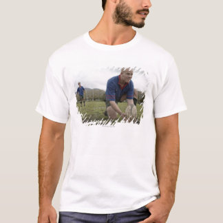 Rugby player positioning ball on rugby pitch T-Shirt