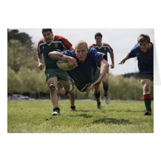 Rugby player scoring jumping on groud with ball card