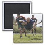 Rugby player scoring jumping on groud with ball fridge magnet