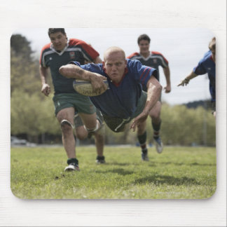 Rugby player scoring jumping on groud with ball mouse pad