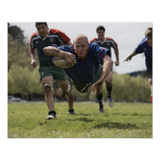 Rugby player scoring jumping on groud with ball posters