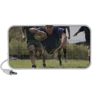 Rugby player scoring jumping on groud with ball travelling speakers