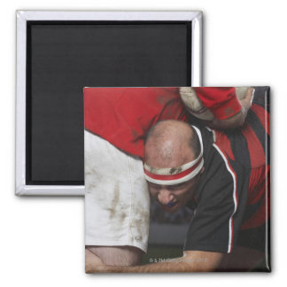 Rugby player tacking opponent, mid section 2 inch square magnet