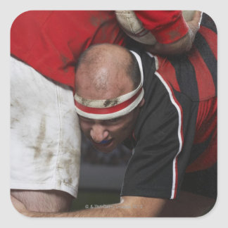 Rugby player tacking opponent, mid section square sticker