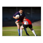 Rugby player tackling another postcard