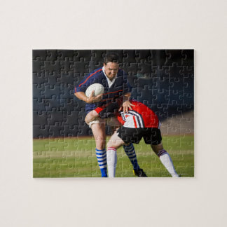 Rugby player tackling another puzzles