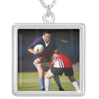 Rugby player tackling another square pendant necklace
