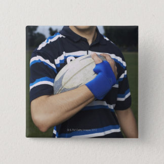 Rugby player with ball button