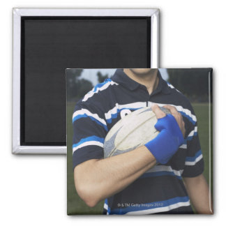 Rugby player with ball refrigerator magnet