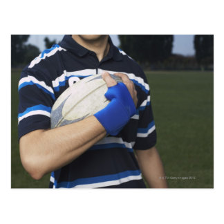 Rugby player with ball postcard