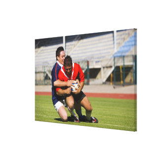 Rugby players fighting for ball canvas print