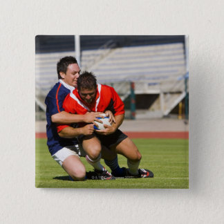 Rugby players fighting for ball pinback button