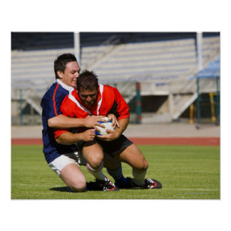 Rugby players fighting for ball poster