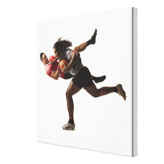 Rugby players tackling for ball canvas print