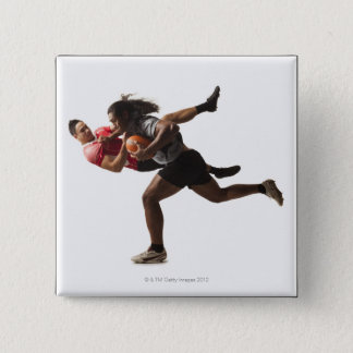 Rugby players tackling for ball pinback button