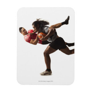 Rugby players tackling for ball rectangular photo magnet