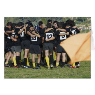 Rugby team standing in a circle card