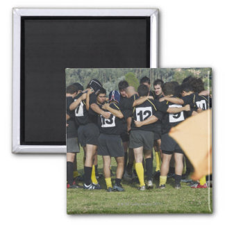 Rugby team standing in a circle refrigerator magnets