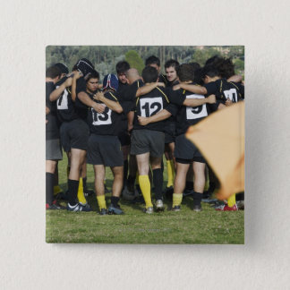 Rugby team standing in a circle pinback button
