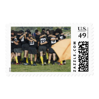 Rugby team standing in a circle postage