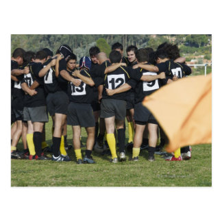 Rugby team standing in a circle postcard