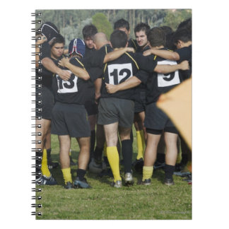 Rugby team standing in a circle spiral notebook