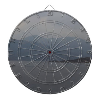 Rugged outdoors and waters of a Loch Dartboard With Darts