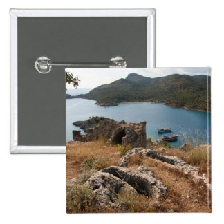 Ruins of ancient burial site on small island pinback button