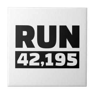 Run 42 kilometers marathon small square tile