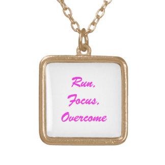 """Run. Focus, Overcome"" gold finish necklace"