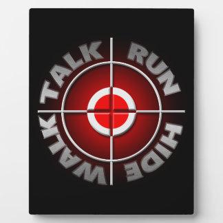 Run walk talk hide. plaque