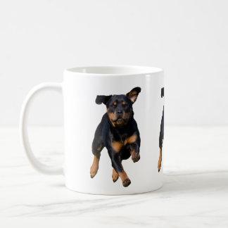 Running rottweiler coffee mug