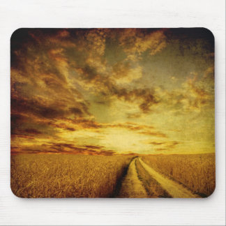 Rural dirt road through the field mouse pad
