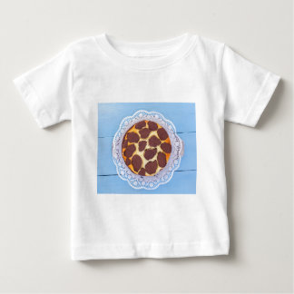 Russian chocolate cheesecake on a blue wooden back baby T-Shirt