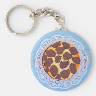 Russian chocolate cheesecake on a blue wooden back basic round button keychain
