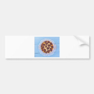 Russian chocolate cheesecake on a blue wooden back bumper sticker