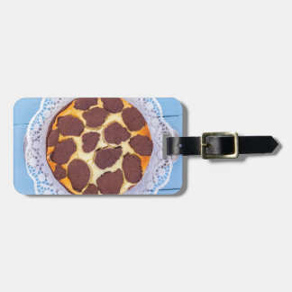 Russian chocolate cheesecake on a blue wooden back luggage tag