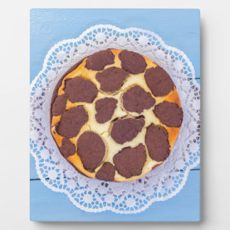 Russian chocolate cheesecake on a blue wooden back plaque