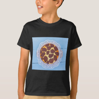 Russian chocolate cheesecake on a blue wooden back T-Shirt