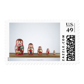 Russian dolls on a shelf. postage stamp