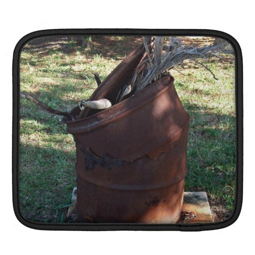 Rusted garbage can in grassy landscape sleeves for iPads