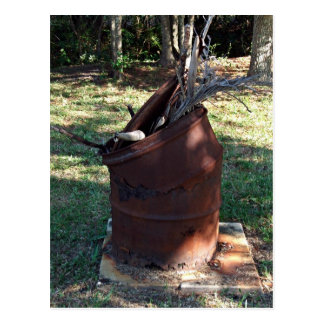 Rusted garbage can in grassy landscape postcard
